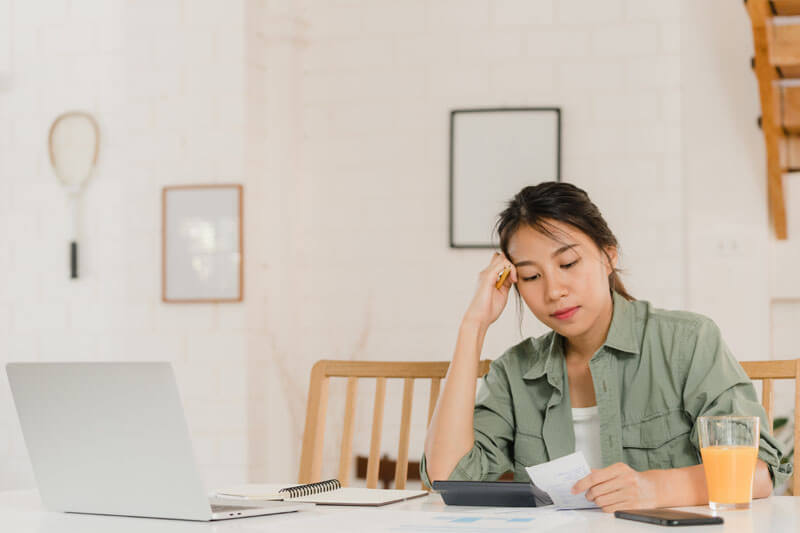 business asian women records income expenses home
